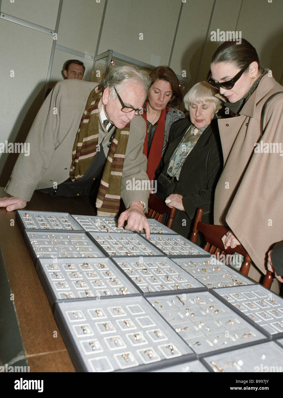Well known French fashion designer Pierre Cardin left examining articles at the St Petersburg jewelry factory Russkiye - Stock Image