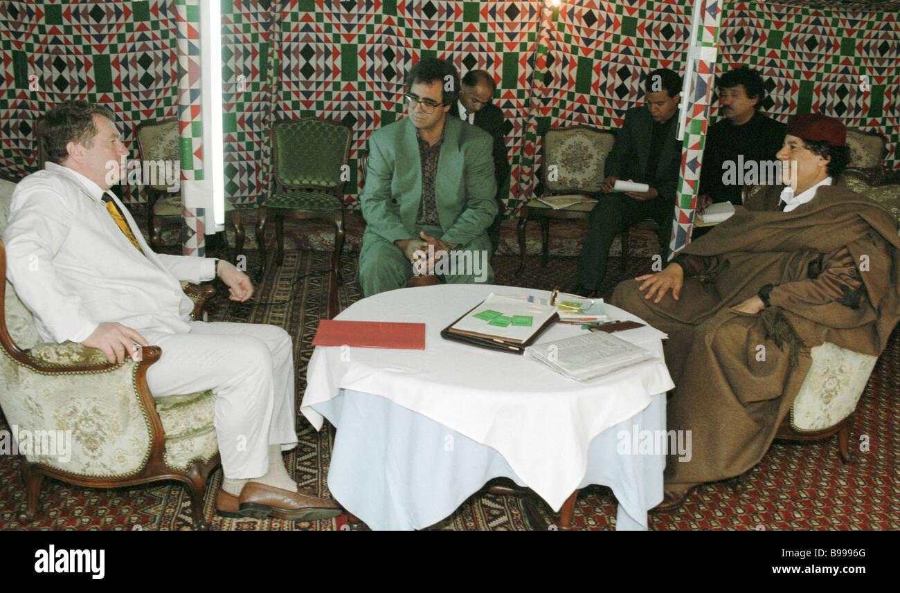 Libya s leader Muammar al Gaddafi right receives Vladimir Zhirinovsky Russian Liberal Democratic Party leader on - Stock Image