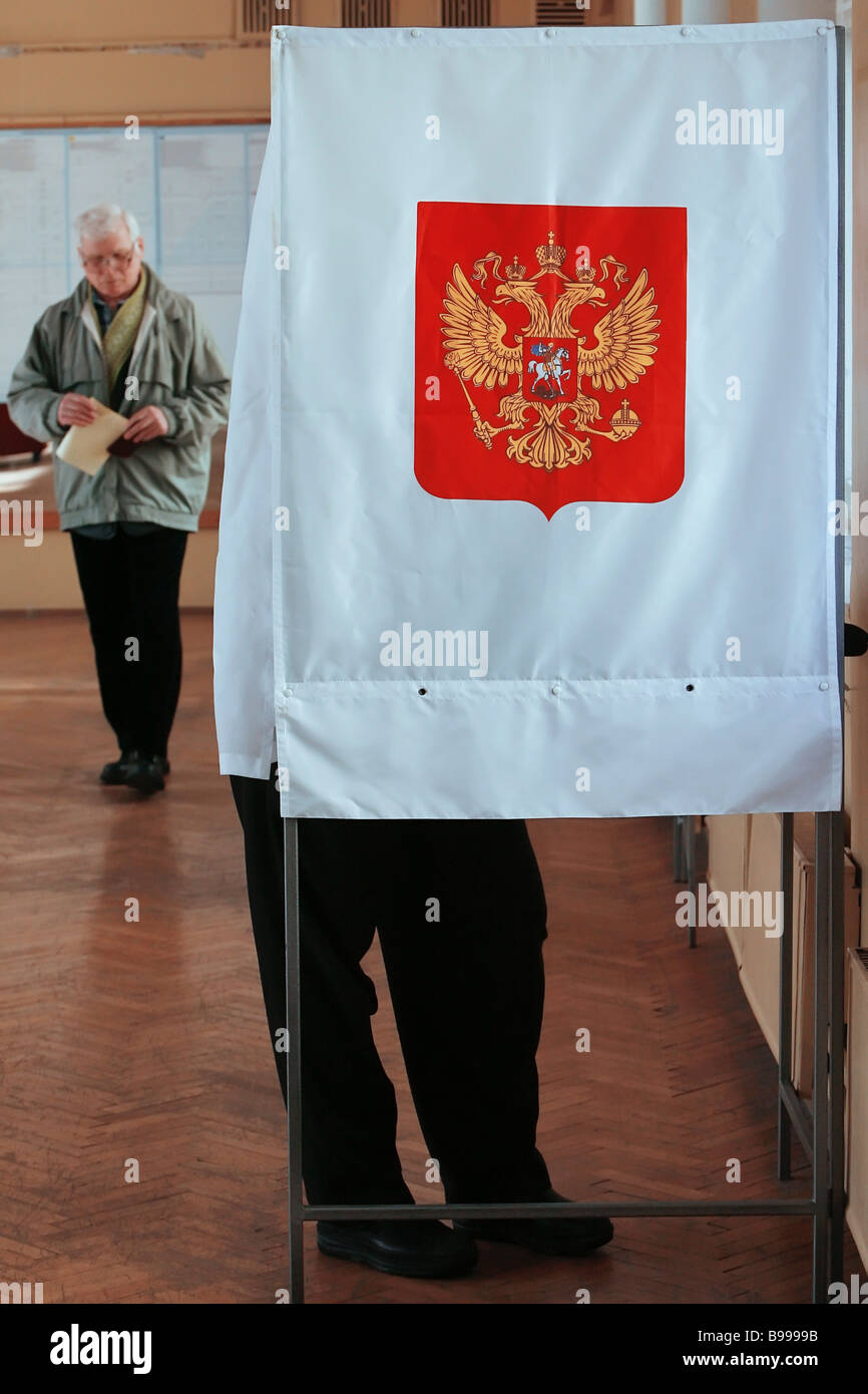 A voter in a polling booth - Stock Image