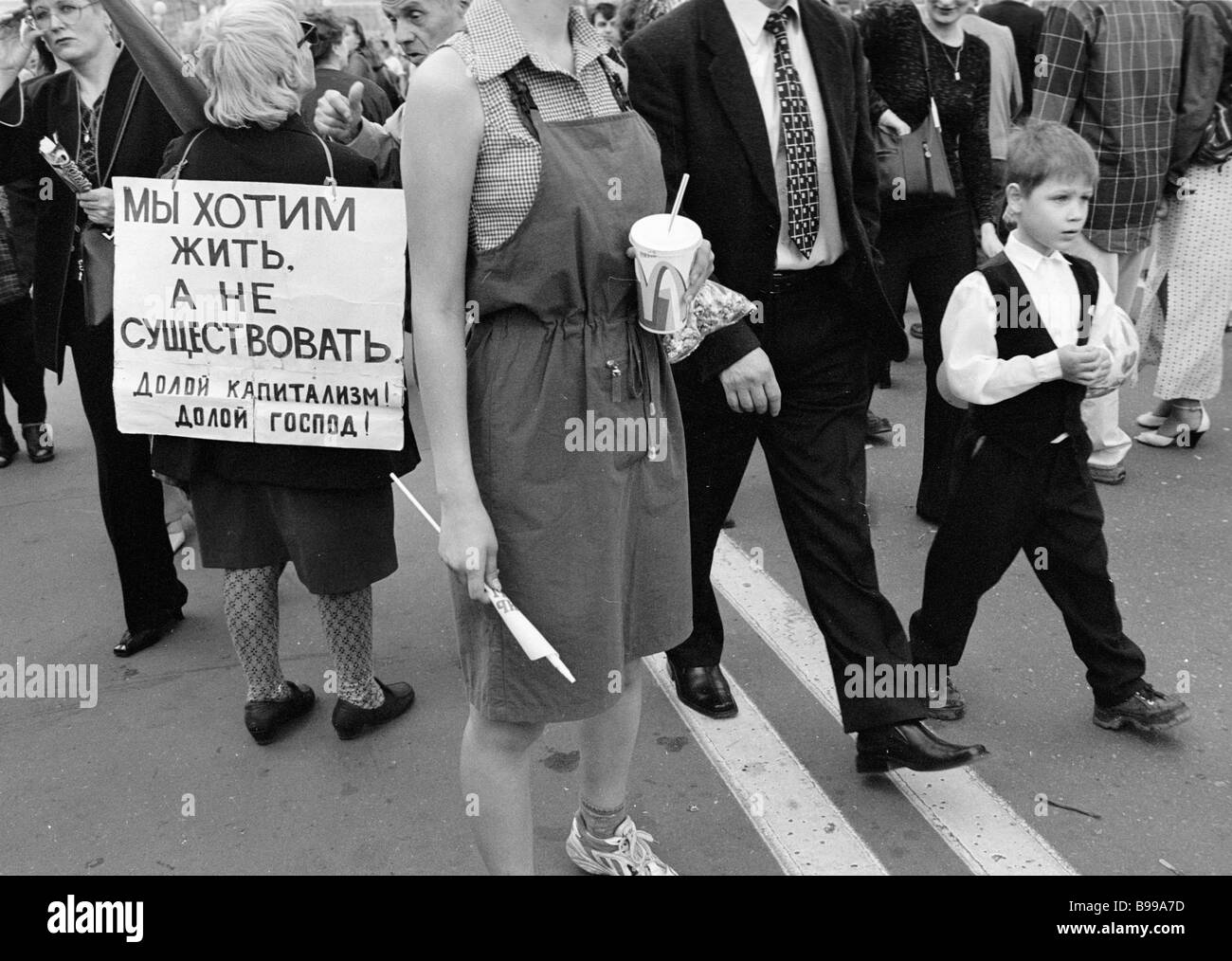 A woman with a poster among the passers by in Manezh square - Stock Image