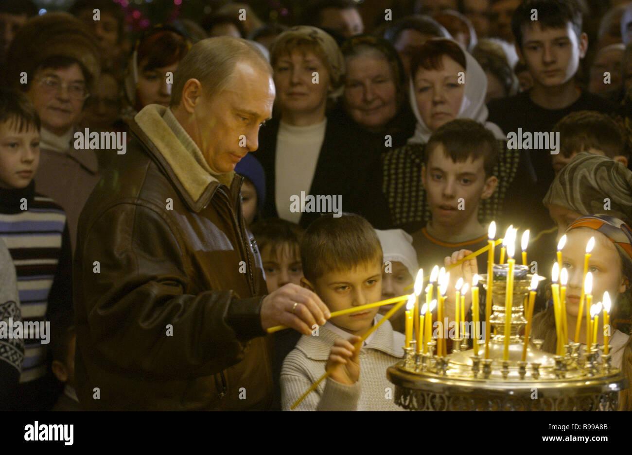 Russian President Vladimir Putin at the Nativity service in the Church of the Nativity of the Blessed Virgin Gorodnya Stock Photo