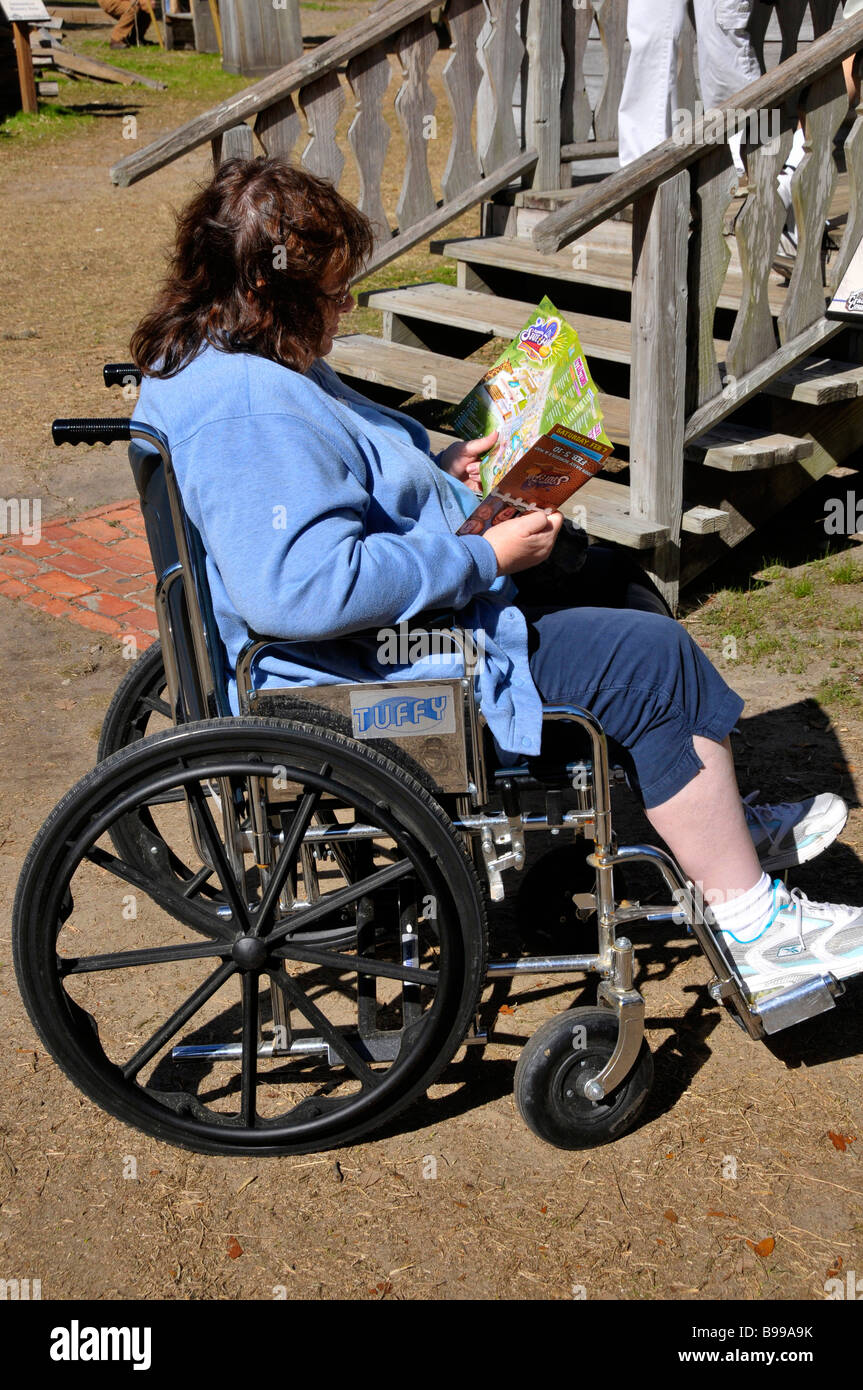 Handicapped Visitor in Wheelchair at Florida State Fairgrounds Tampa - Stock Image