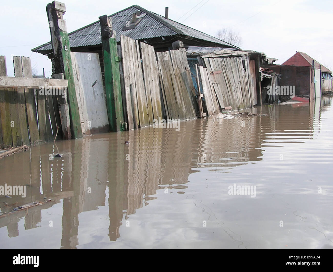 The second wave of floods coming to the Altai region continues the underflooding of residential houses in Biysk - Stock Image