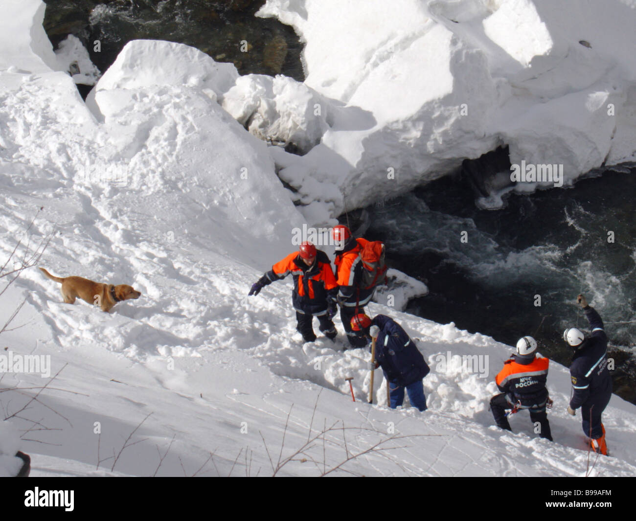 Rescuers of the North Ossetian Emergencies Ministry busy with post avalanching clean up - Stock Image