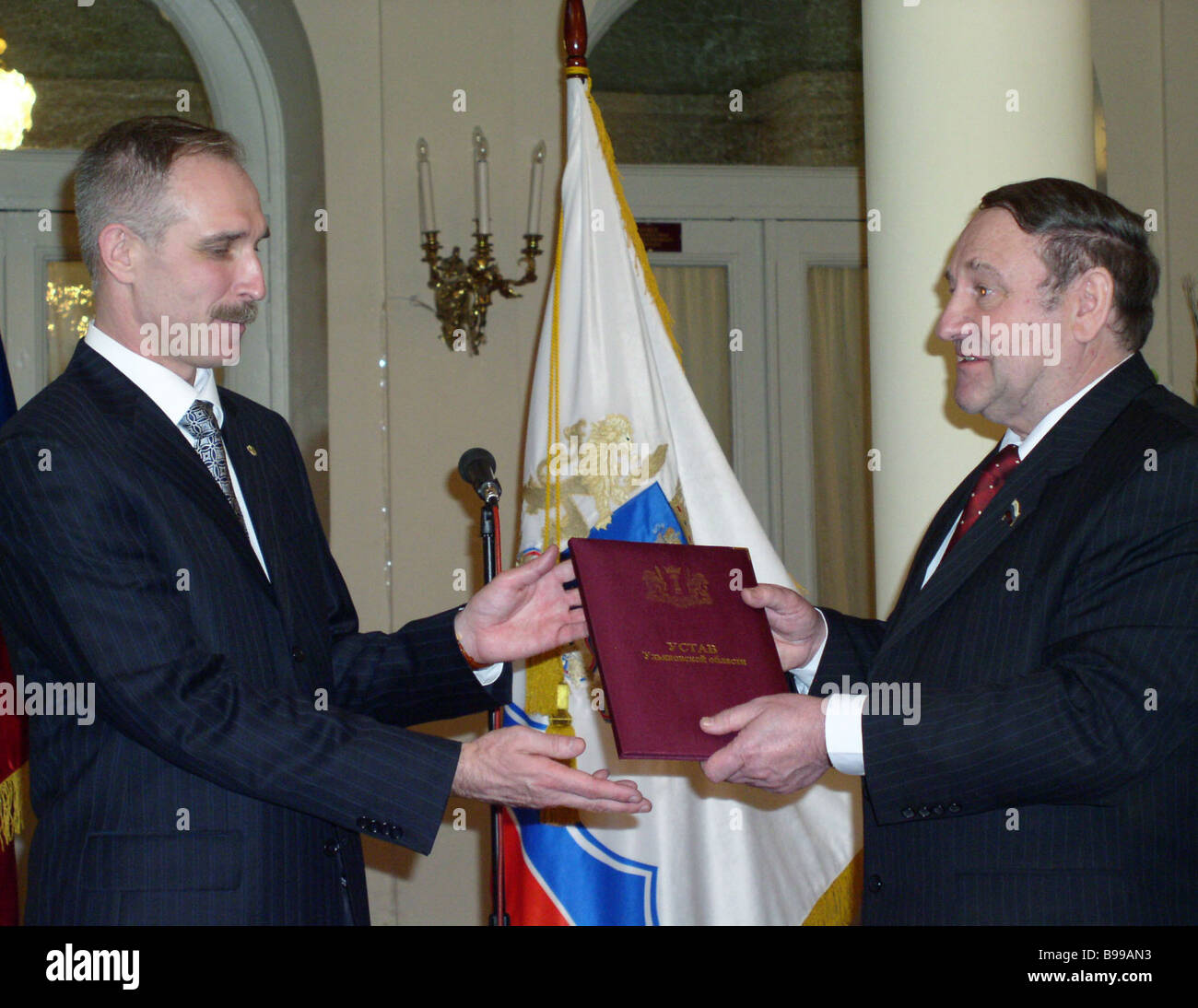 Ulyanovsk region governor Sergei Morozov left accepts the Ulyanovsk region Charter from the chairman of the Regional - Stock Image