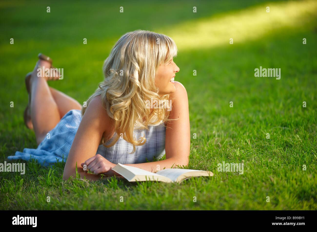 Girl lying in park Stock Photo