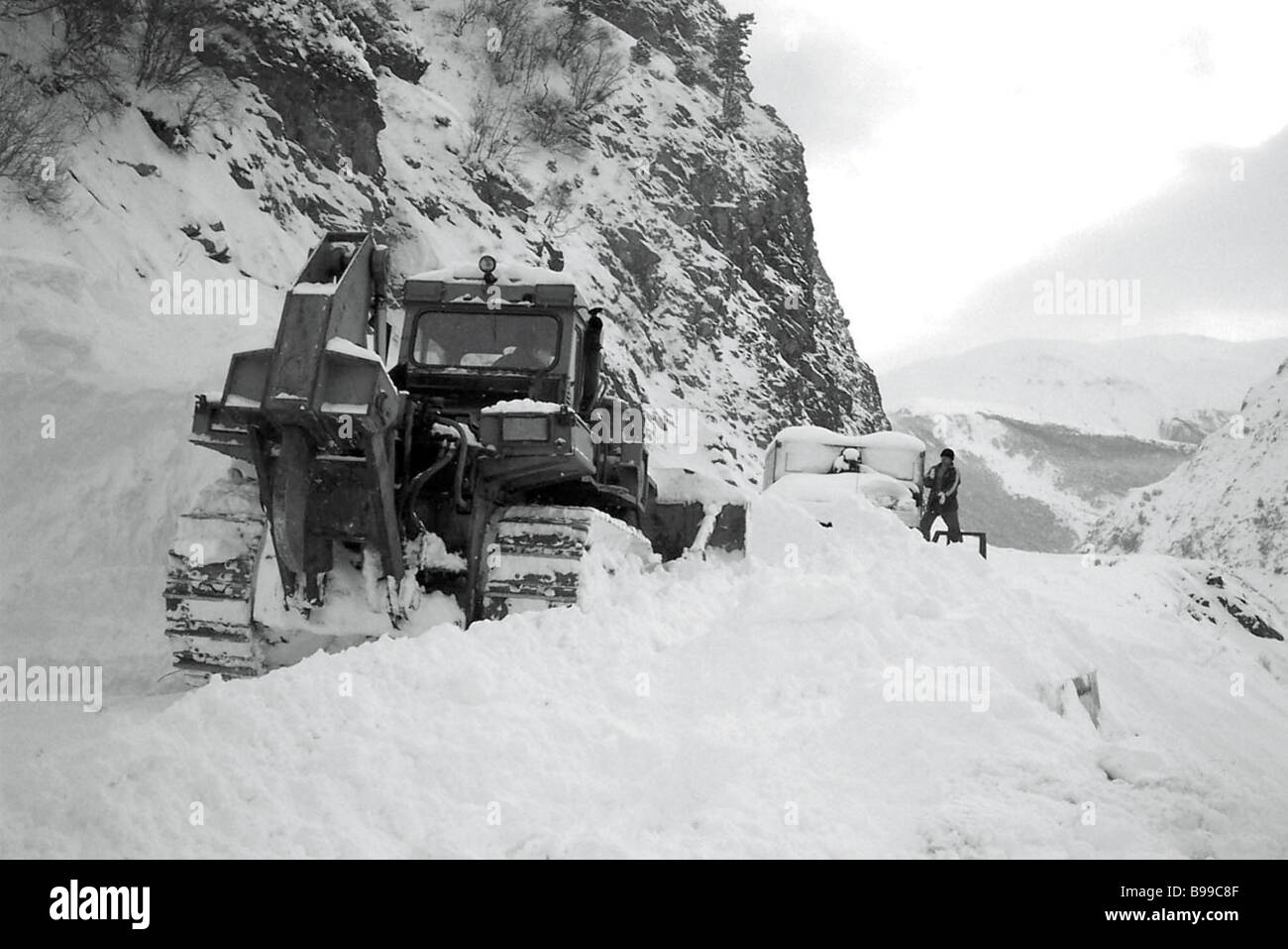 Building temporary road after an avalanche in North Ossetia - Stock Image