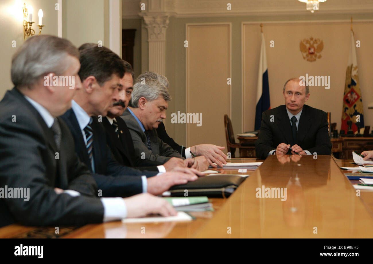 Russian President Vladimir Putin right during a meeting in Novo Ogaryovo - Stock Image