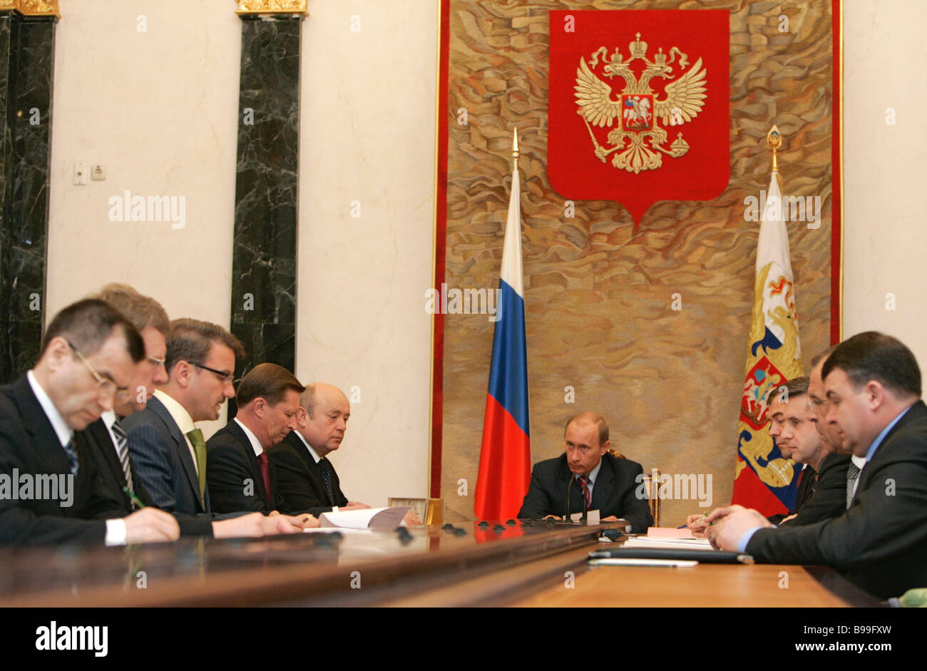 Russian President Vladimir Putin Center At A Meeting With The Cabinet In The  Kremlin