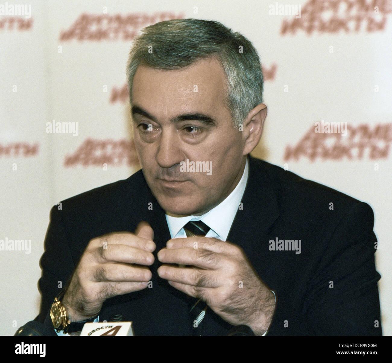 Ingushetia s President Murat Zyazikov facing reporters at RIA Novosti news conference - Stock Image