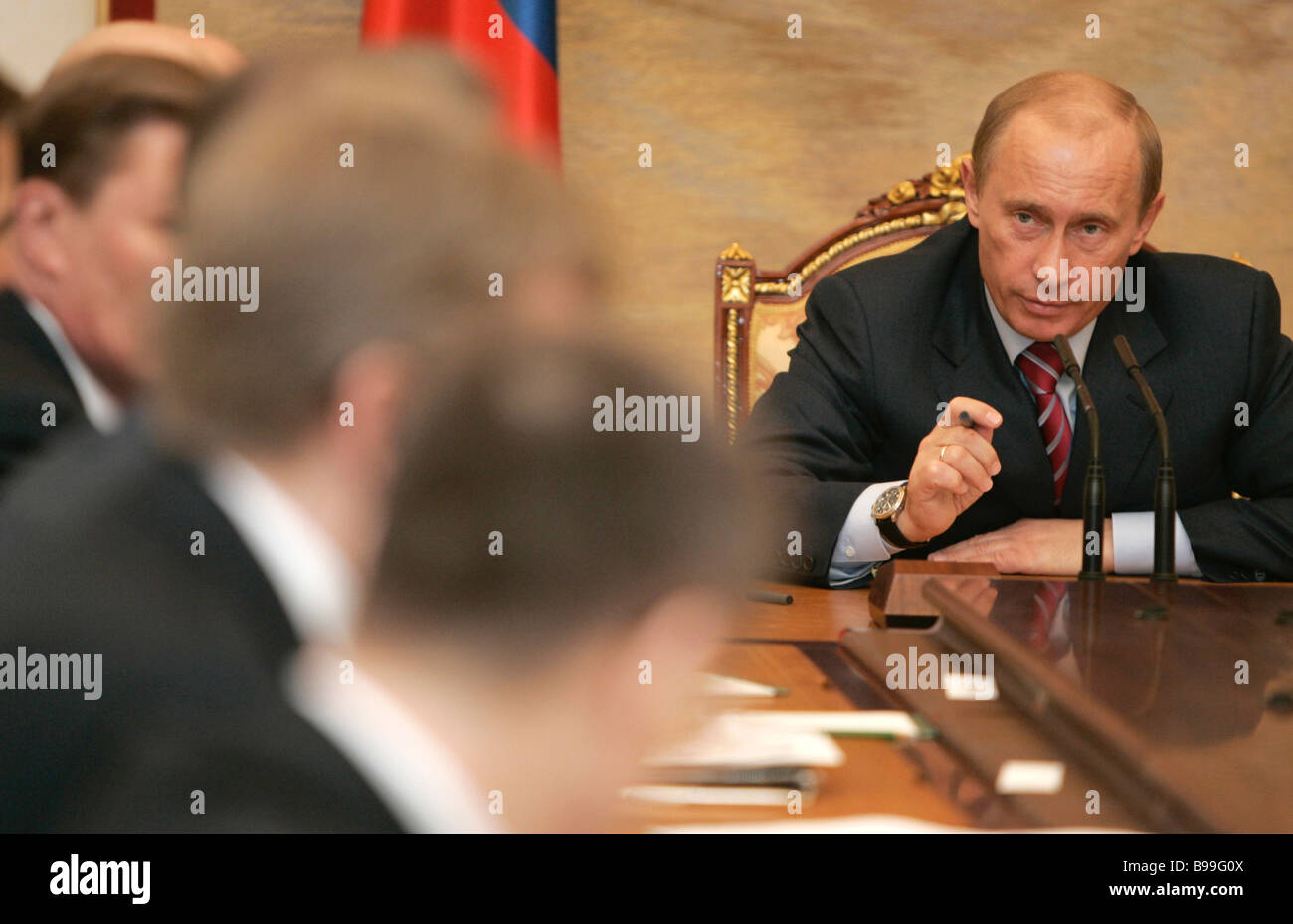 Russian President Vladimir Putin right during a Cabinet meeting in the Kremlin - Stock Image