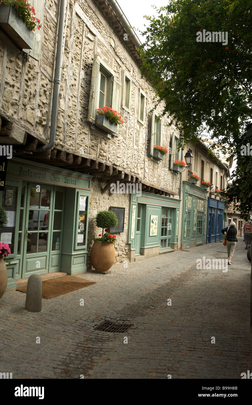 A French Street Scene with shop fronts and no people in portrait - Stock Image