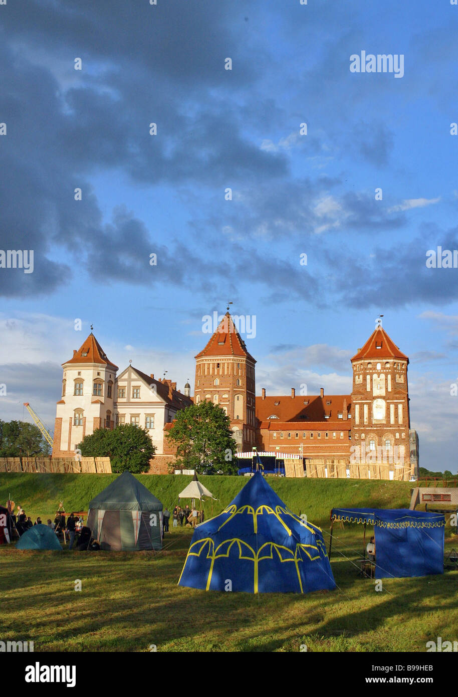 Minsk chivalry clubs hold a gathering in front of the Mirsky Castle Mir Grodno Region Belarus The castle was built - Stock Image