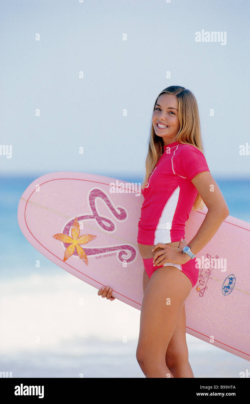 Young girl with surfboard - Stock Image