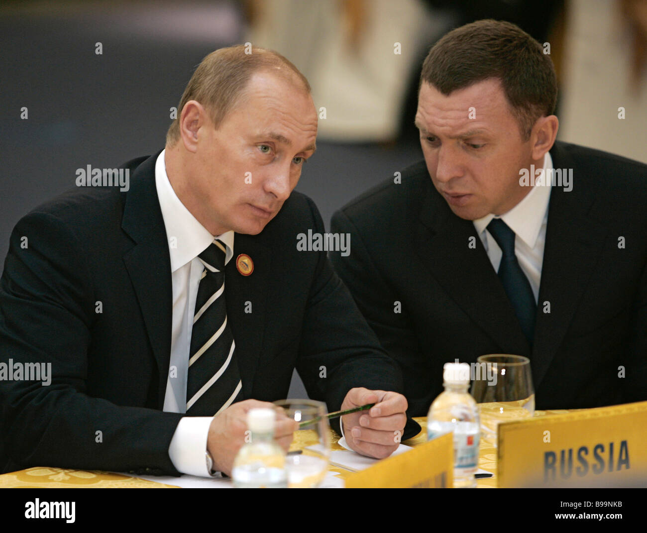 Russian President Vladimir Putin and Oleg Deripaska Board Chairman of aluminium giant OAO RUSAL left to right attend Stock Photo