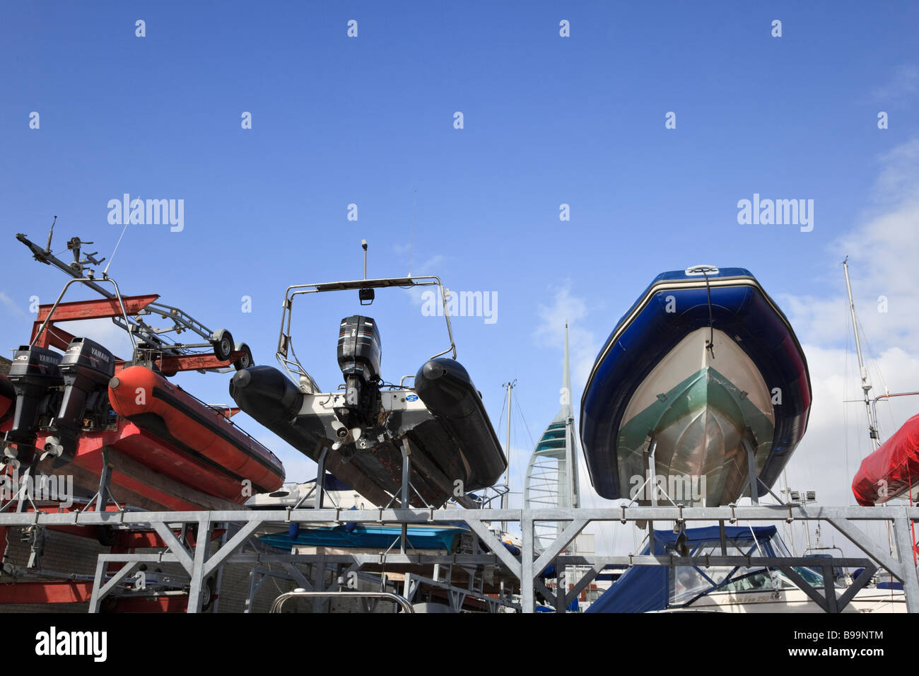 RIBs in a Rack in Portsmouth showing the outboard motors. - Stock Image