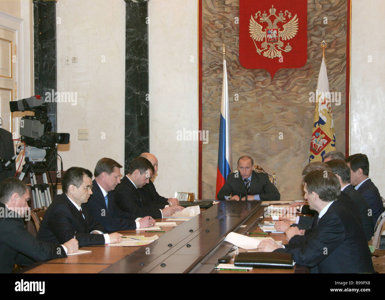 Russian President Vladimir Putin center at a cabinet meeting in the Kremlin - Stock Image