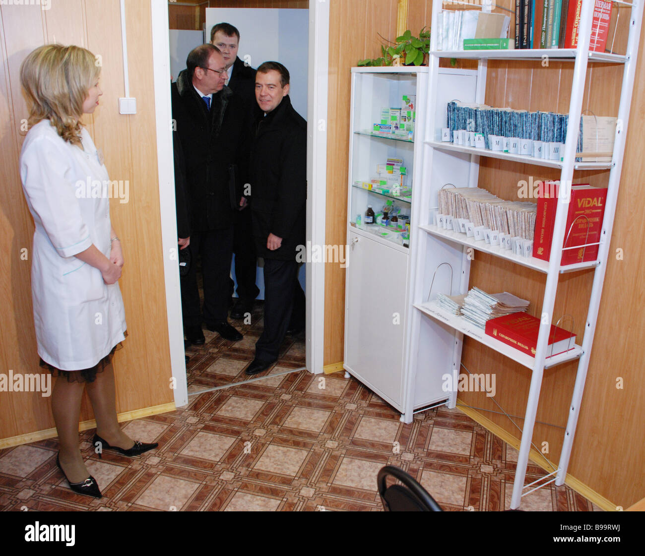Dmitry Medvedev Russian First Deputy Prime Minister to the right in the doorway visiting a first aid post and maternity - Stock Image