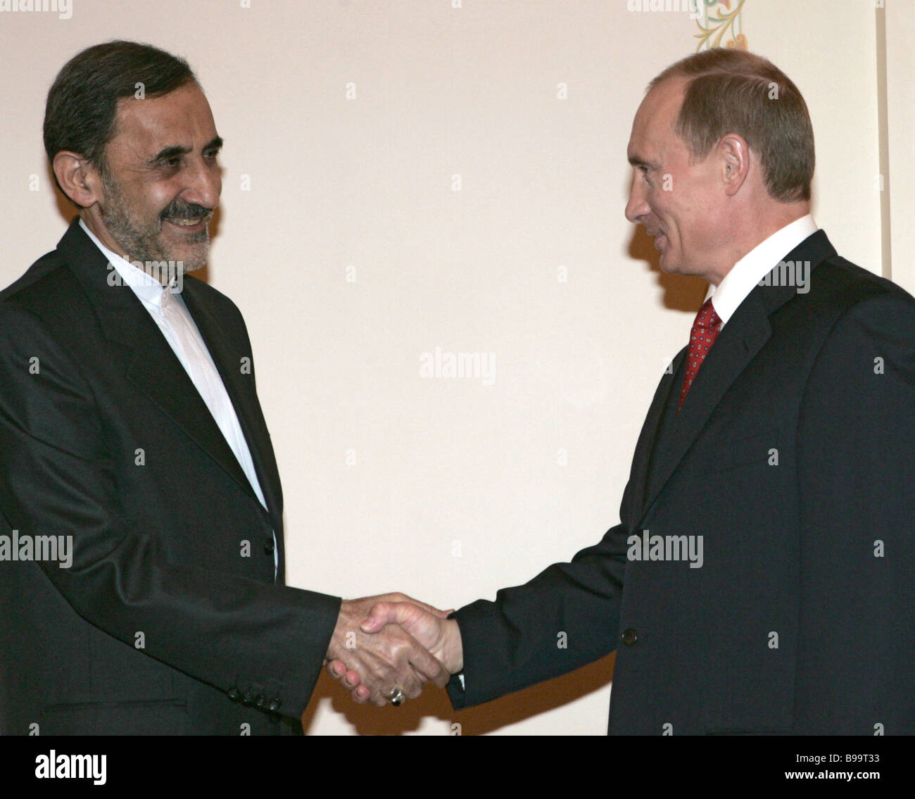 Ali Akbar Velayati foreign policy counselor of the Supreme Leader of Iran and Russian President Vladimir Putin left - Stock Image