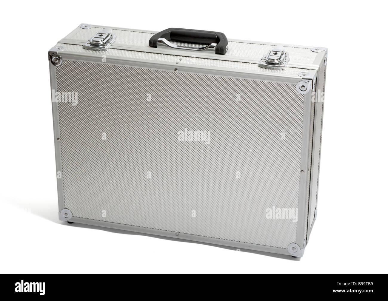 Old lockable silver aluminium case on white background - Stock Image
