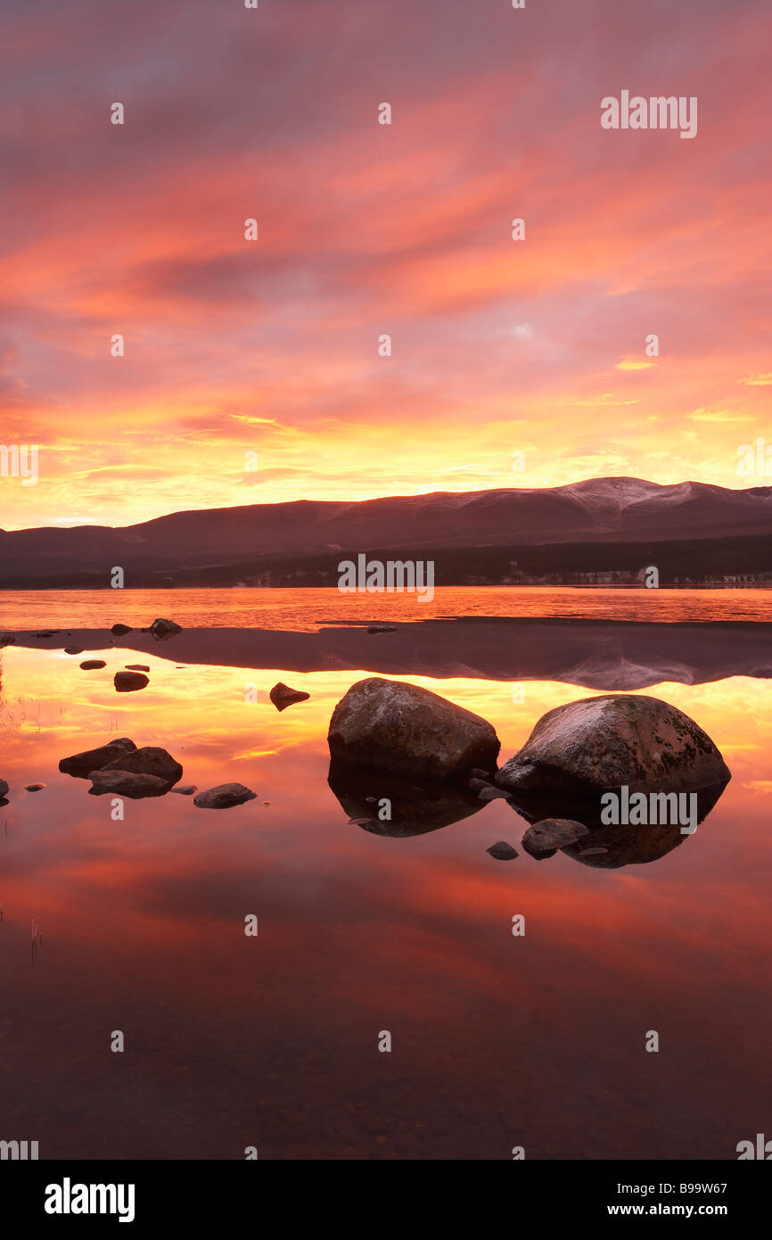 Loch Morlich and Cairngorm Mountains at dawn - Stock Image