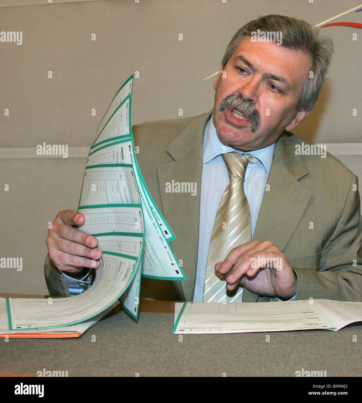 Vladimir Sokolin head of the Federal Statistical State Service shows census sheets at the conference on holding - Stock Image