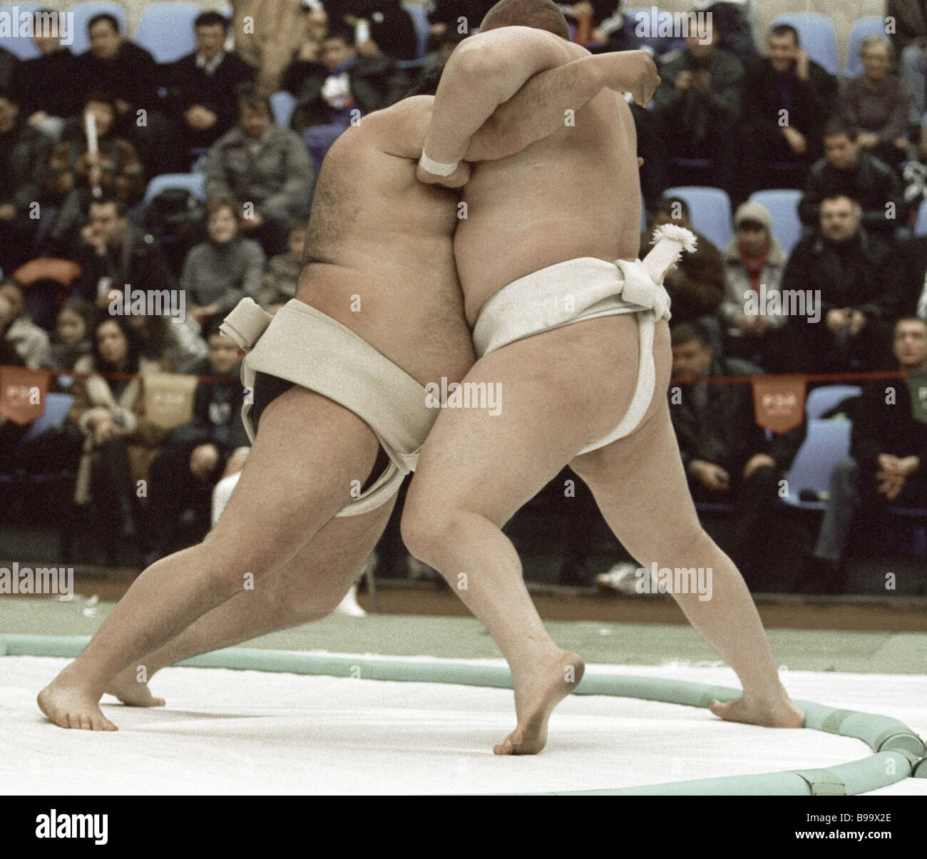 A wrestling bout at Moscow International Sumo Top Category Tournament - Stock Image