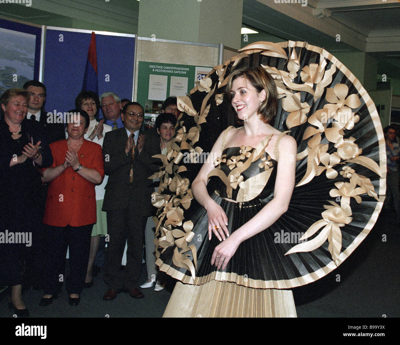 A model demonstrating a dress featuring folk motifs at an exhibition dedicated to Days of Karelia in the State Duma - Stock Image