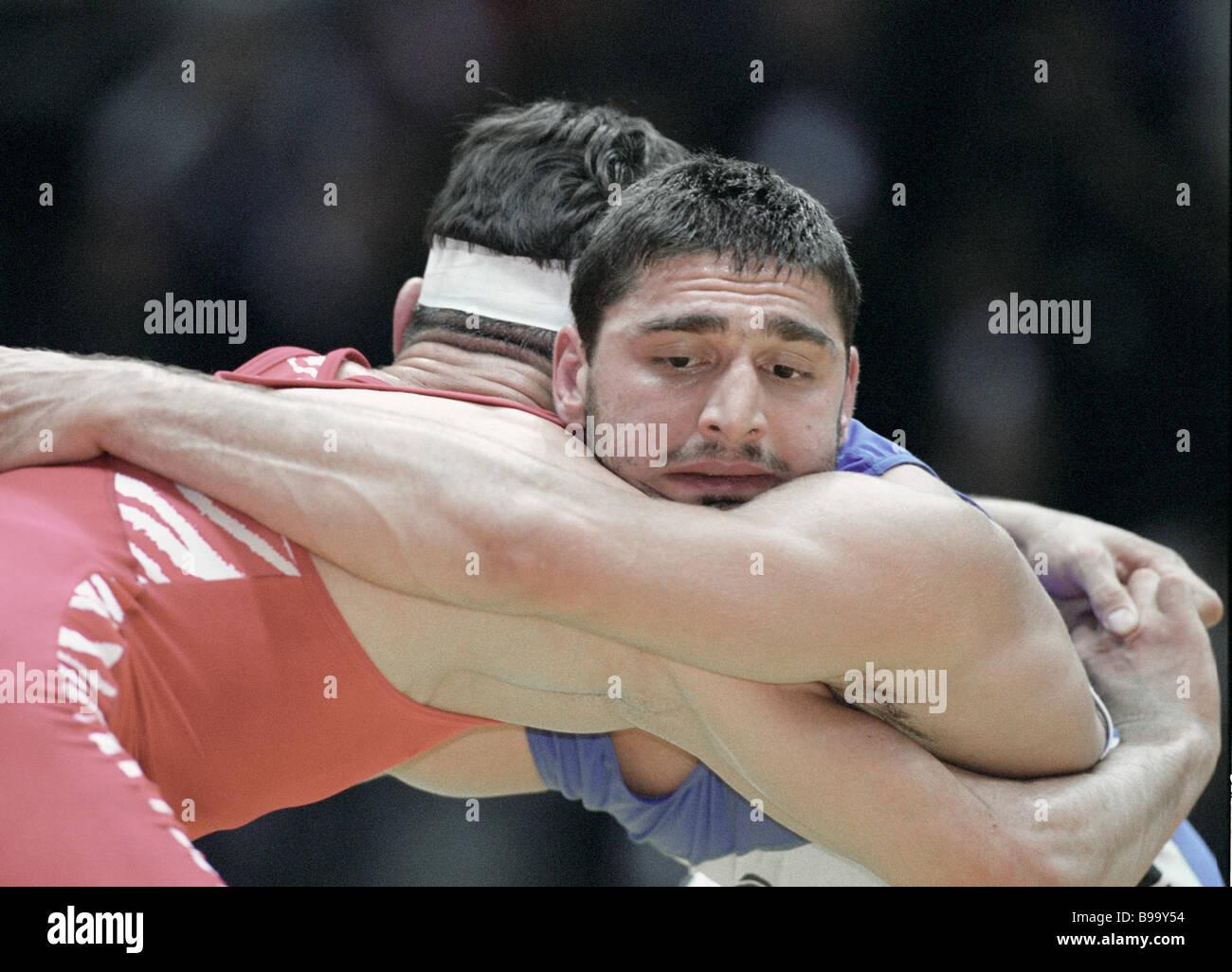 Wrestlers Varteres Samurgashev and Badri Khasaya right in the final bout GR World championships - Stock Image