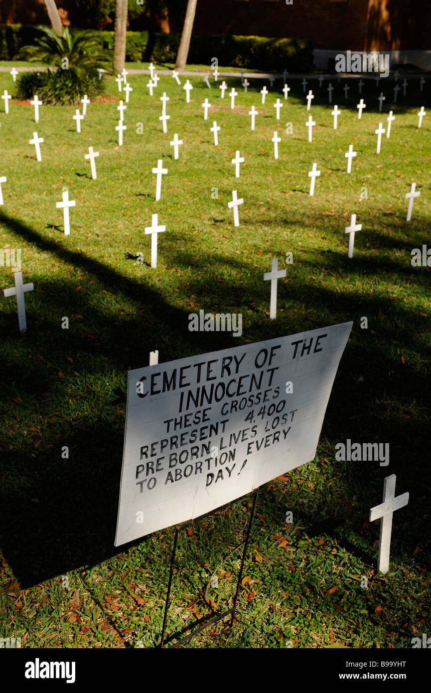 Crosses and sign on church lawn represent abortions performed - Stock Image