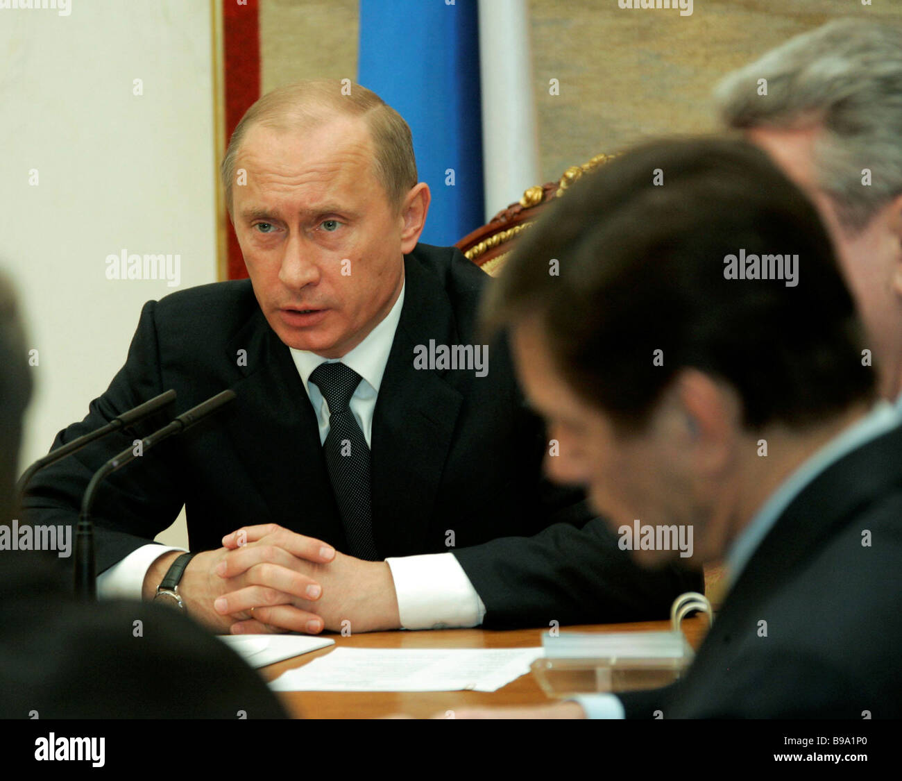Russian President Vladimir Putin confers with Russian Government s members in the Kremlin - Stock Image