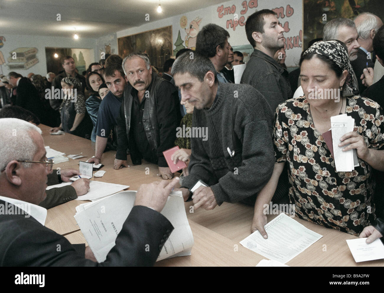 Villagers of Tsentoroy get their voting ballots during the Chechen Republic presidential election campaign - Stock Image