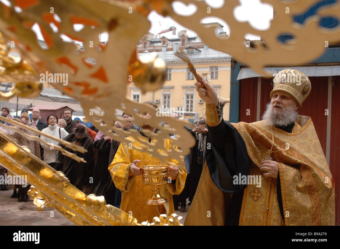 A bishop blesses a cross to be mounted on the dome of the Church of the Apparition of Our Lady The church in Sheremetyev - Stock Image