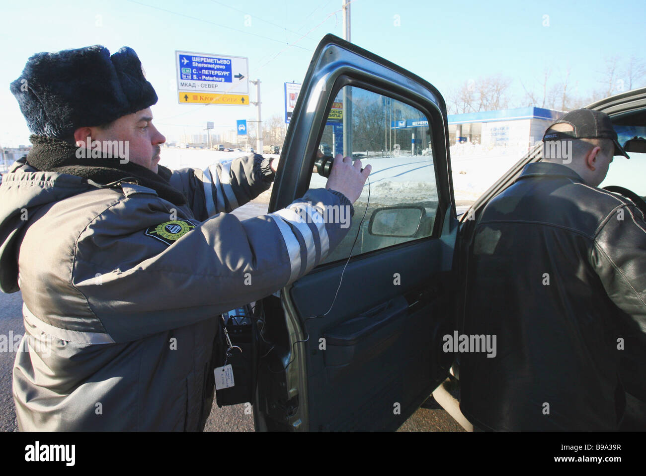 A traffic police inspector checking tinted car window transparency in the Volokolamskoye Highway Moscow Federal - Stock Image