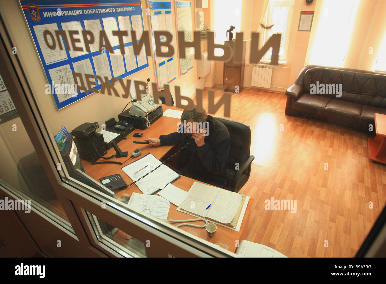 An Emergencies Ministry duty officer in his office in Sochi a Winter Olympic bidder resort on the Russian Black - Stock Image