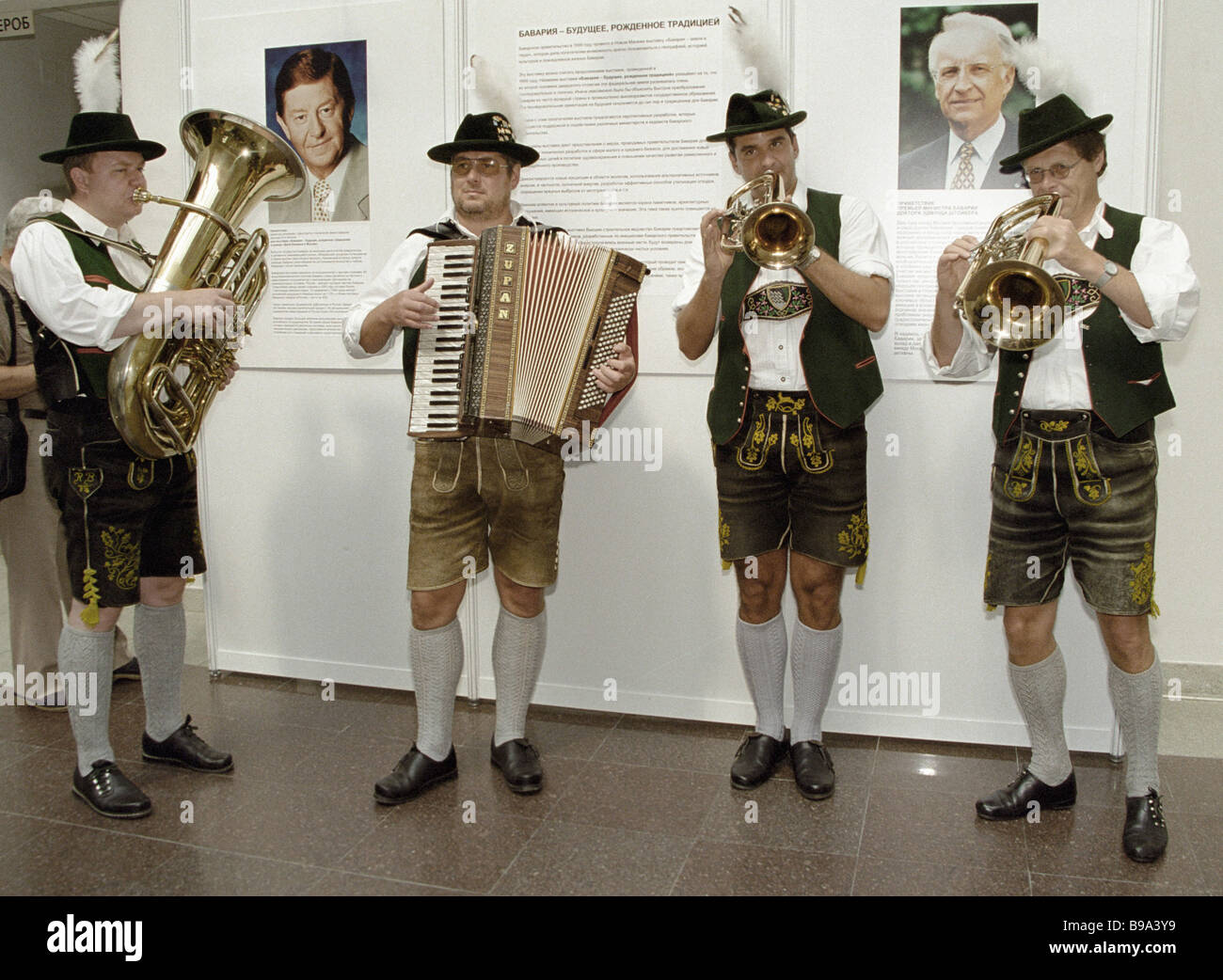 Bavarian folk music company performing at the exhibition Bavarian Traditions Will Stay - Stock Image