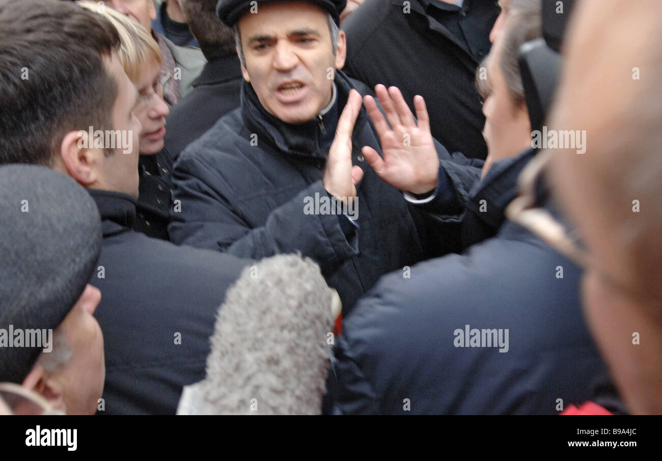 Garri Kasparov center the leader of the United Civic Front attending Dissenter March rally held on Triumphalnaya - Stock Image