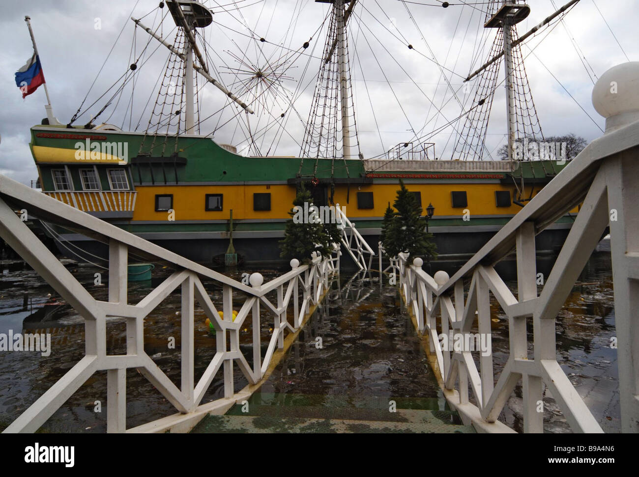 The restaurant ship Flagman is stranded on its Neva River moorage during an inundation in St Petersburg - Stock Image