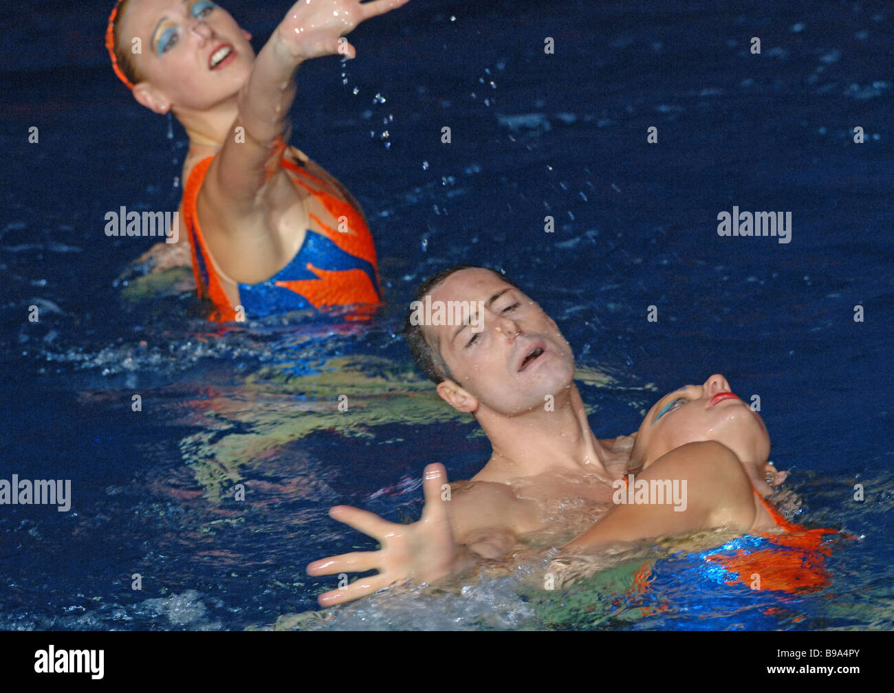 Bill May the U S synchronized swimming star the only man in the world in this sport performing with Olga Kuzhela - Stock Image