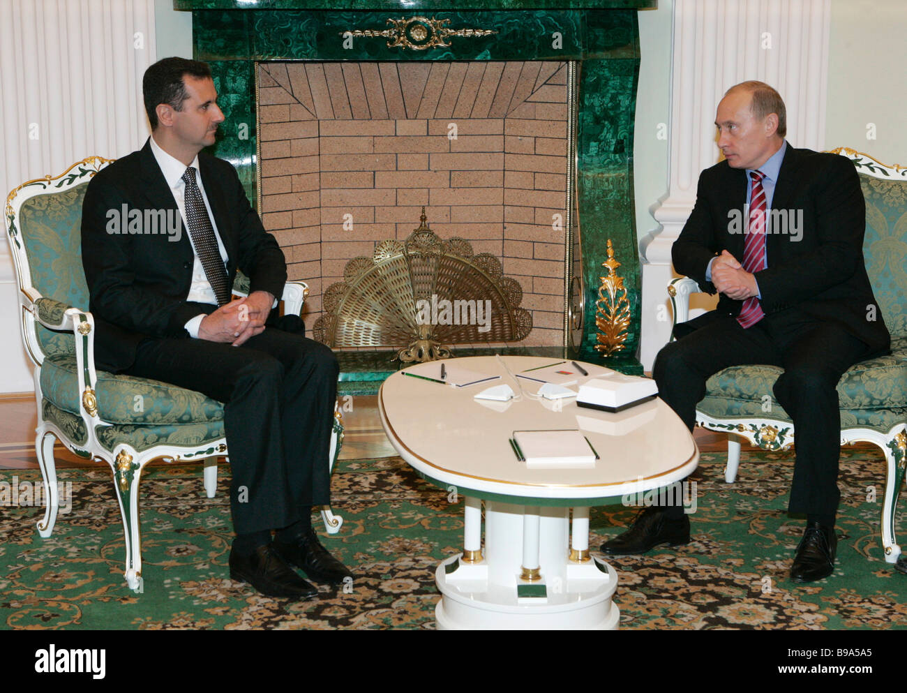 Syrian President Bashar Al Assad and Russian President Vladimir Putin left to right meet each other in the Kremlin - Stock Image