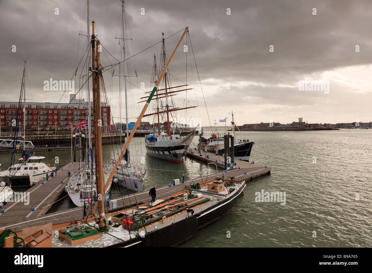 Sunset over traditional sailing vessels Gunwharf Quays Portsmouth - Stock Image