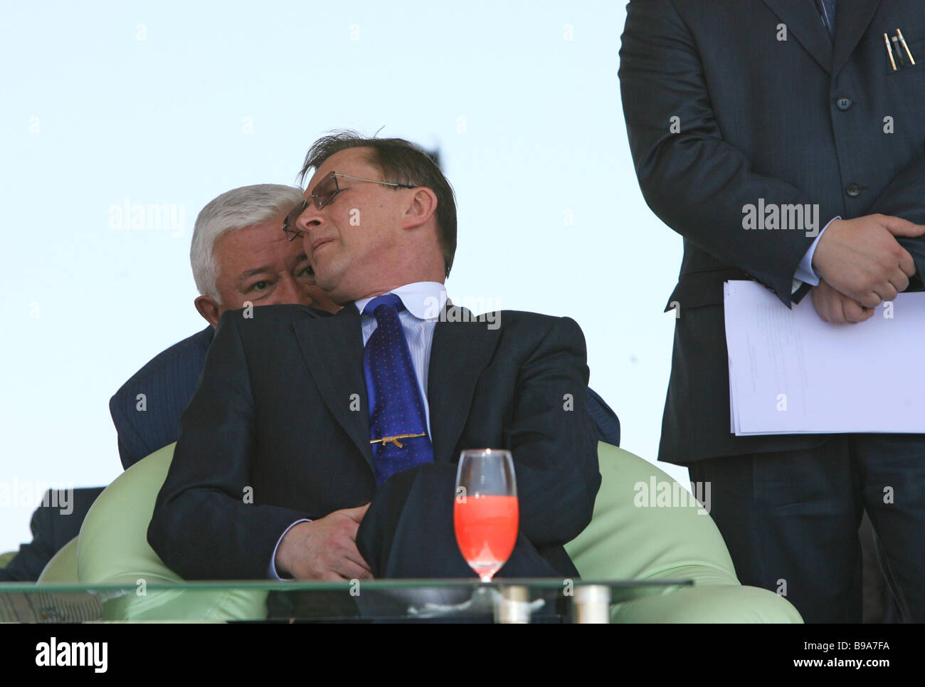 Russia s Defense Minister Sergei Ivanov front row and Oleg Demchenko president of Irkut Corporation back row during - Stock Image