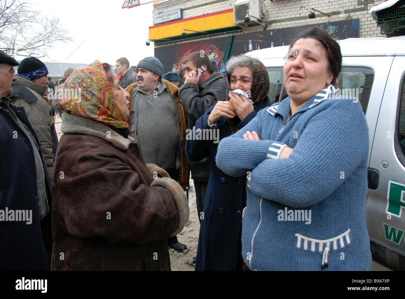 The bereaved gather at Moscow s Basmanny Market after a roof collapse - Stock Image