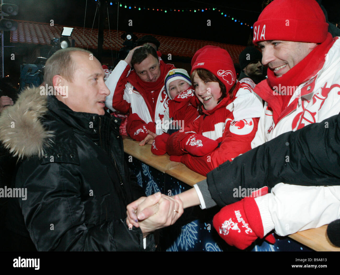 Russian President Vladimir Putin left talks to young athletes while visiting the Red Square skating rink next to - Stock Image