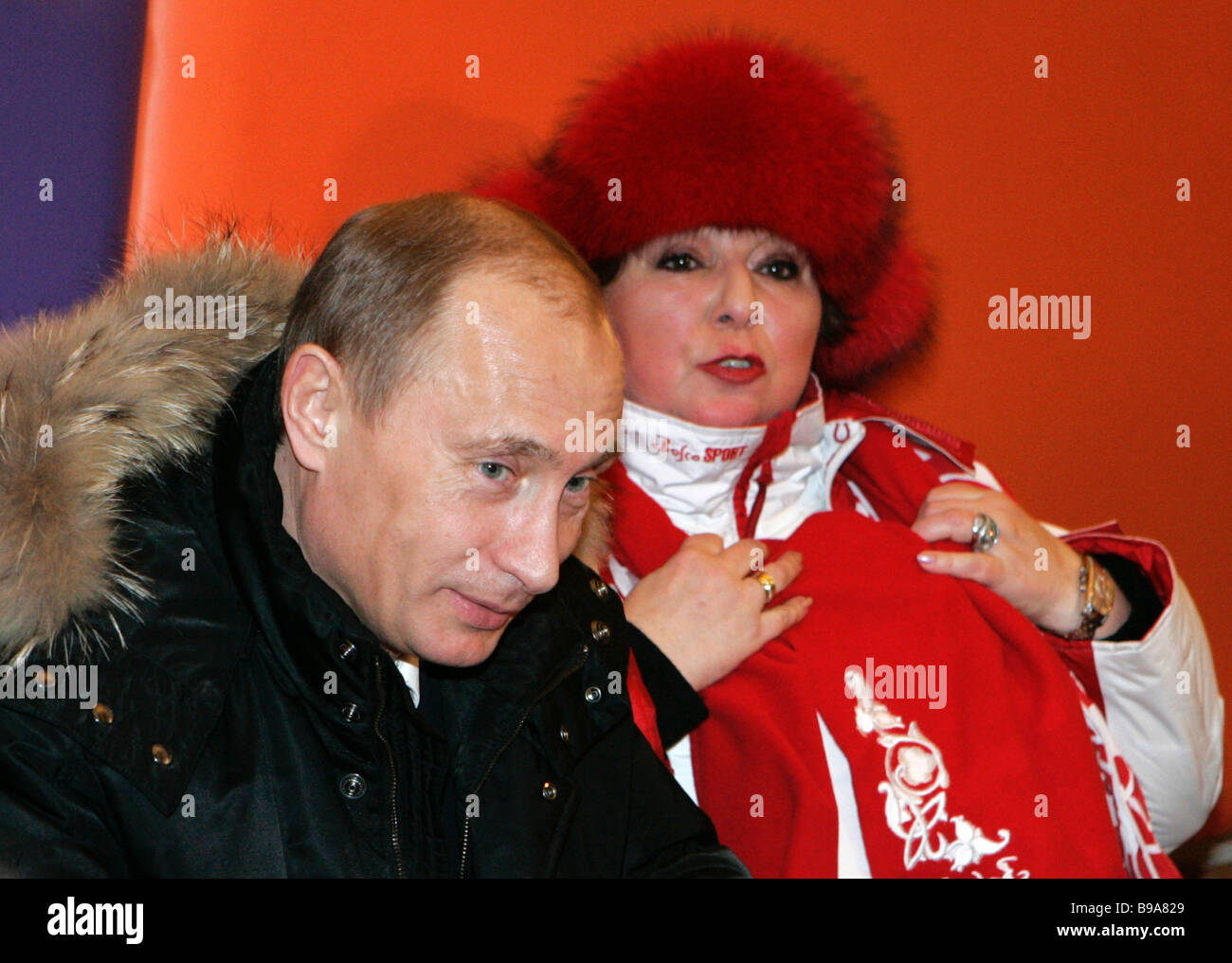 Russian President Vladimir Putin talks to top notch figure skating trainer Tatyana Tarasova while visiting the Red - Stock Image