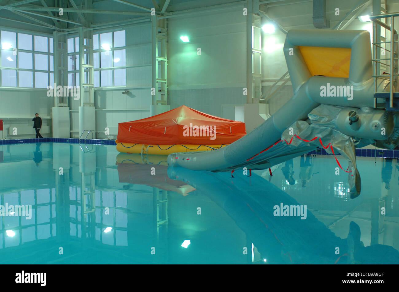 Water Land simulator facility for emergency training of flight crews - Stock Image