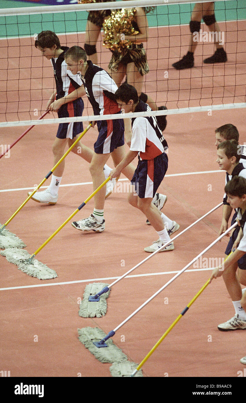 Preparing a volleyball pitch for play - Stock Image