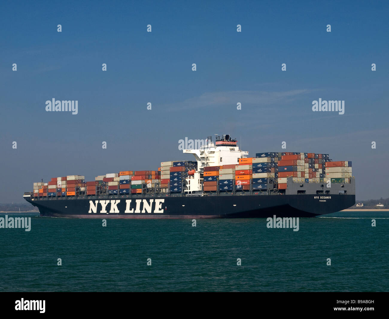 Container ship NYK Oceanus arriving at Southampton UK - Stock Image
