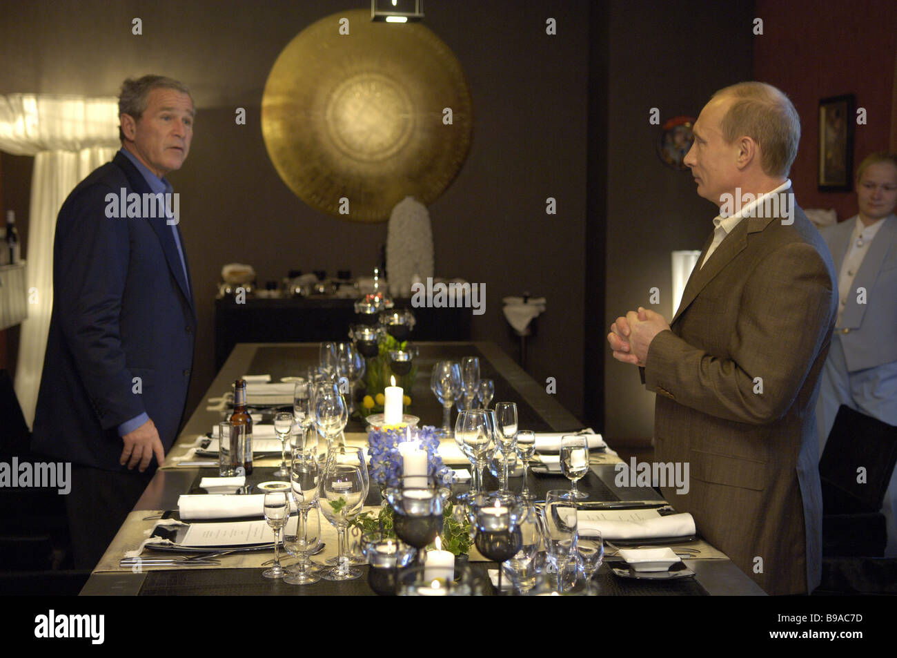 American President George Bush left and Russia s President Vladimir Putin at informal dinner - Stock Image