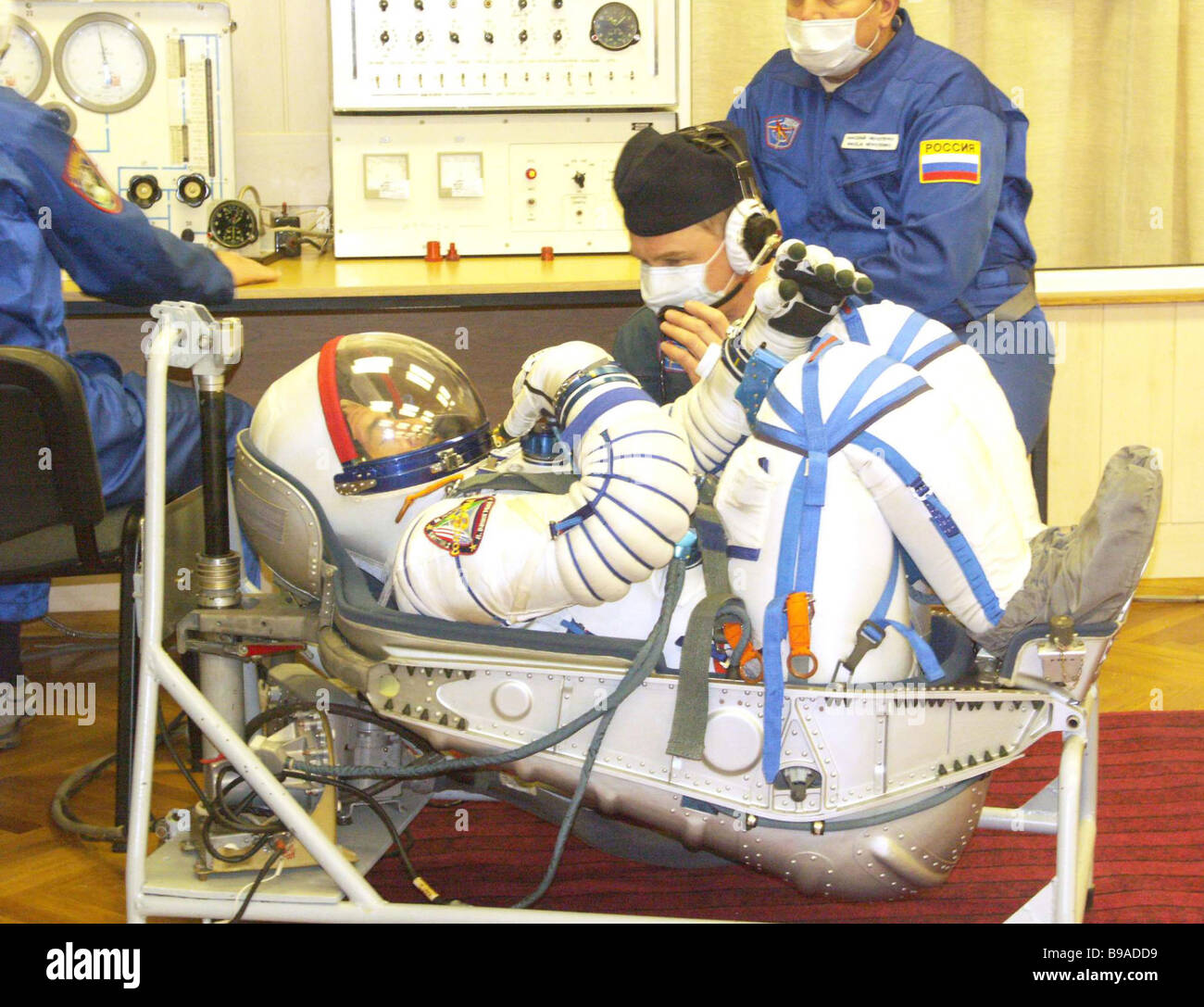 Ship Commander Pavel Vinogradov trying on a spacesuit On the Baikonur cosmodrome the flight and stand by crews of - Stock Image
